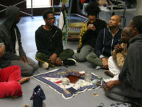Living Legacy Artist Ralph Lemon (center) in dialogue with his collaborators during his 2010 MANCC residency for How Can You Stay All Day and Not Go Anywhere?